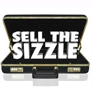 Sell the Sizzle words popping out of a suitcase